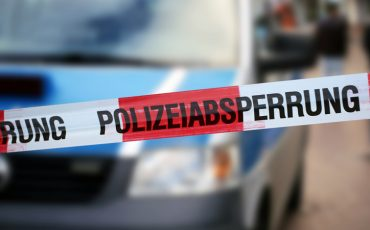 """Police cordon tape with the german word """"Polizeiabsperrung"""""""